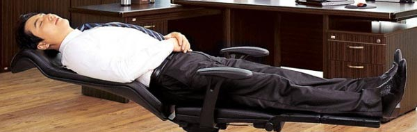 Man relaxing on clean office chair