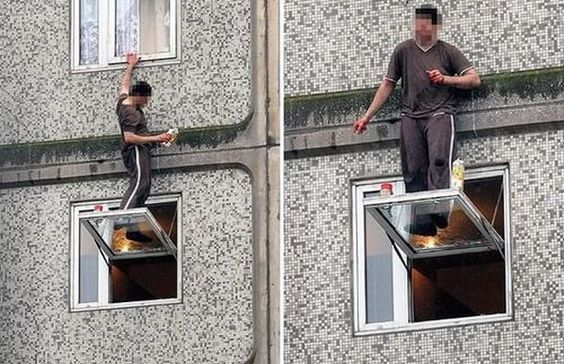 Man dangerously cleaning windows