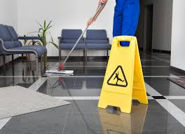 Office floor being mopped
